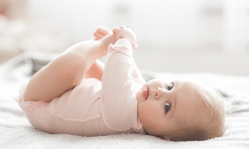 Baby holding its toes